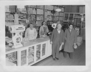 "Italian-American Cooperative of Clifton, NJ. Behind counter: left, Charles Bertolotti, mgr.; right: ""Rennie"", head butcher."